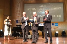 Alain Lunzenfichter receives AIMS Lifetime Achievement Award